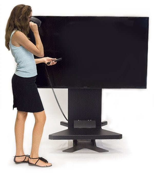 A Woman Lifts Her Large Screen HDTV Display With One-Button Lifting-While-Drinking-Her-Coffee