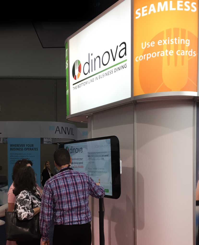 Dinova shows its new app to booth VIP's before their trade show booth opens.