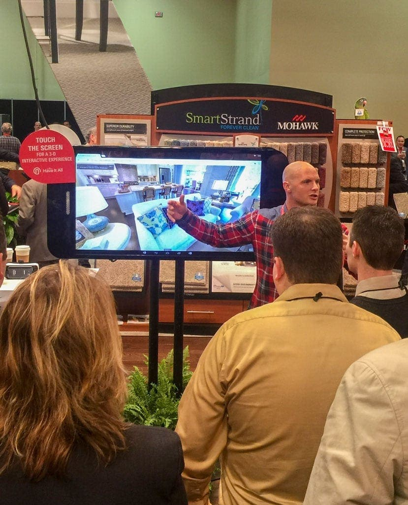 Mohawk flooring shows off their new app to a crowd at a Trade Show.
