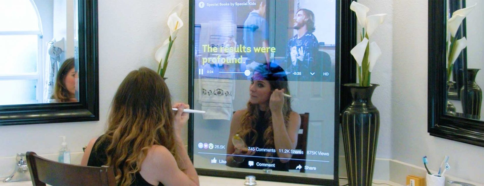 A woman sits in front of her smart mirror, made by Crunchy Logistics.
