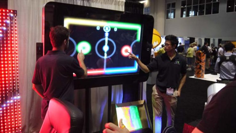 Playing-Glow-Hockey-On-A-Giant-iPhone-Giant-iPad